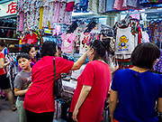 09 JULY 2017 - SINGAPORE: Women shop for clothes in Tiong Bahru market. Tiong Bahru market, in the midst of the Tiong Bahru Housing estate, was the first indoor market in Singapore and is considered one of the best markets in Singapore. It was built in 1955 in an effort to organize vendors and get them off the neighborhood streets. Tiong Bahru neighborhood is now one of the most popular neighborhoods in Singapore for both expats and Singaporeans.    PHOTO BY JACK KURTZ