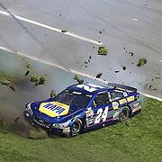 Race car driver Chase Elliott (24) slides across the grass in the front stretch during the 58th Annual NASCAR Daytona 500 auto race at Daytona International Speedway on Sunday, February 21, 2016 in Daytona Beach, Florida.  (Alex Menendez via AP)