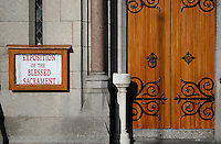 Exposition of the Blessed Sacrament sign on the outside of St Josephs catholic church in Glasthule Dublin Ireland