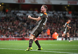 Brentford's Alan Judge celebrates scoring his side's first goal of the game during the Carabao Cup, Third Round match at the Emirates Stadium, London.