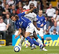 Photo: Daniel Hambury.<br /> Fulham v Everton. The Barclays Premiership.<br /> 27/08/2005.<br /> Fulham's Luis Boa Morte holds onto Everton's Tim Cahill.