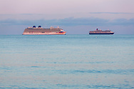 P&O Cruises' largest ship, Britannia (left) and Cunard's Queen Victoria, at anchor in Weymouth Bay. The cruise industry has suffered a complete shutdown during the covid-19 pandemic and many vessels are currently waiting at various anchorages around the coast of Great Britain and the world.<br /> Picture date Tuesday 1st September, 2020.<br /> Picture by Christopher Ison. Contact +447544 044177 chris@christopherison.com