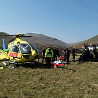 Scotland's Charity Air Ambulance (SCAA) Firefighters from Alloa and a specialist line rescue team from Lochgelly Fire Station assist SCAA paramedics Rich Garside and Daz O'Brien by transporting the casualty from the accident site in Dollar Quarry to the helicopter landing site by a polaris vehicle.…19.04.19<br />Picture by Graeme Hart.<br />Copyright Perthshire Picture Agency<br />Tel: 01738 623350  Mobile: 07990 594431