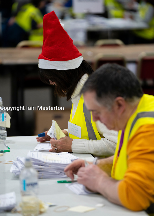 Edinburgh, Scotland, UK. 12th December 2019. Staff counting ballot papers at Parliamentary General Election Count at the Royal Highland Centre in Edinburgh. Iain Masterton/Alamy Live News