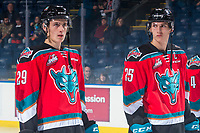 KELOWNA, CANADA - OCTOBER 27: Brothers Nolan Foote #29 and Cal Foote #25 of the Kelowna Rockets line up at the start of the game against the Tri-City Americans on October 27, 2017 at Prospera Place in Kelowna, British Columbia, Canada.  (Photo by Marissa Baecker/Shoot the Breeze)  *** Local Caption ***
