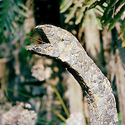 A snake mosaic statue at the Edward James Surrealist Gardens at Las Pozas, Xilitla, Mexico