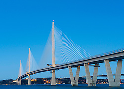 Dusk view of new Queensferry Crossing bridge spanning the River Forth at South Queensferry, Scotland, United Kingdom.