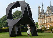 © Licensed to London News Pictures. 24/05/2012. Waddesdon, UK. Kathryn Hobbs shades under a sculpture by John Pawson. People enjoy the warm weather amongst an exhibition of contemporary sculpture at Waddesdon Manor, Buckinghamshire, today 24th May 2012. The exhibition is being held by Christie's as part of a private sale. Photo credit : Stephen Simpson/LNP