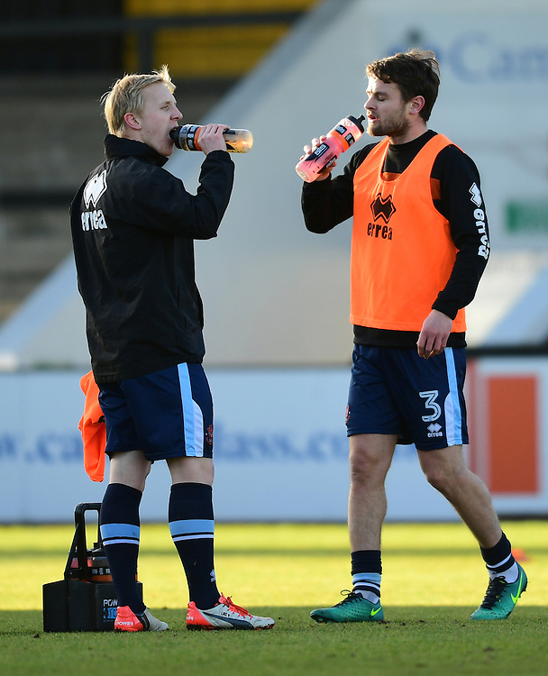 Blackpool's Mark Cullen, left, with team-mate Andy Taylor during the pre-match warm-up <br /> <br /> Photographer Chris Vaughan/CameraSport<br /> <br /> The EFL Sky Bet League Two - Cambridge United v Blackpool - Saturday 14th January 2017 - The Cambs Glass Stadium - Cambridge<br /> <br /> World Copyright © 2017 CameraSport. All rights reserved. 43 Linden Ave. Countesthorpe. Leicester. England. LE8 5PG - Tel: +44 (0) 116 277 4147 - admin@camerasport.com - www.camerasport.com
