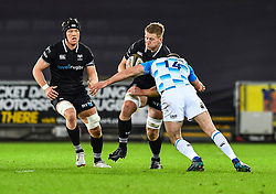 Ospreys' Bradley Davies is tackled by Leinster's Fergus McFadden<br /> <br /> Photographer Craig Thomas/Replay Images<br /> <br /> Guinness PRO14 Round 18 - Ospreys v Leinster - Saturday 24th March 2018 - Liberty Stadium - Swansea<br /> <br /> World Copyright © Replay Images . All rights reserved. info@replayimages.co.uk - http://replayimages.co.uk