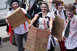 London, July 10th 2014. Protesters dressed as Zombies march with thousands of striking teachers, government workers and firefighters through London in protest against cuts and working conditions.