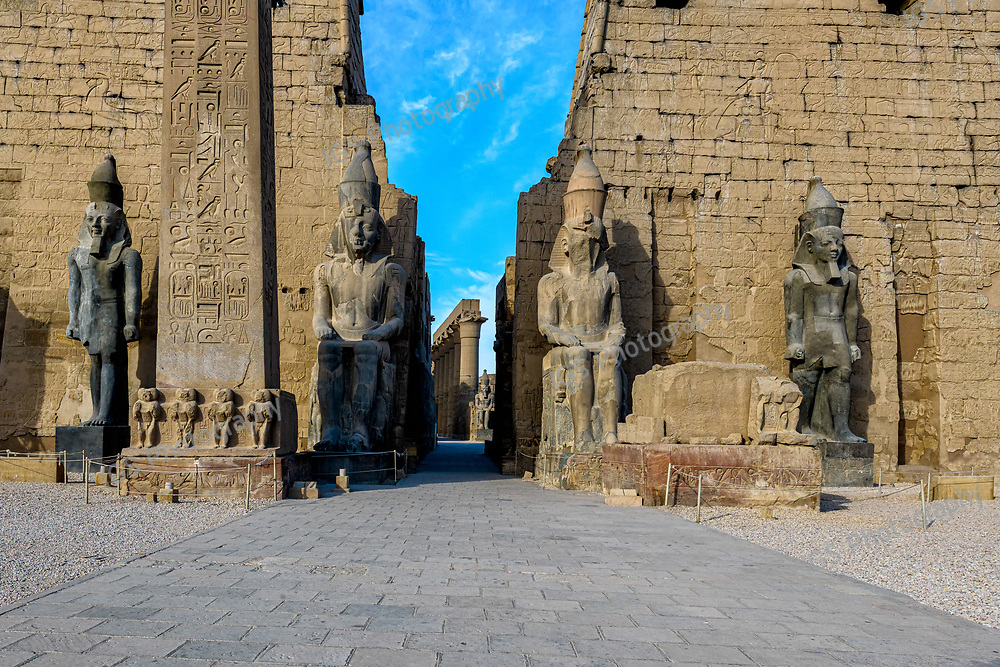 The entrance to the Luxor Temple with the massive First Pylon and  Colossal statues of Rameses II