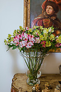 Yellow and pink flower arrangement in a home
