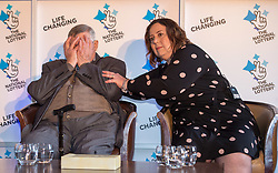 © Licensed to London News Pictures. 20/02/2018. Tortworth Court, Wotton-under-Edge, Gloucestershire, UK. Family of six win £18.1m on Lotto. The BANFIELD family, left-right: dad Dennis age 87, daughter Karen, age 51. A family syndicate from Bristol are celebrating after their Lucky Dip ticket matched all six numbers to scoop the £18,139,352 Lotto Jackpot last Saturday. The win, which mum and dad had always told their two daughters was just a matter of time, will mean travel to international sporting fixtures, new cars and a stress-free future for them all. Photo credit: Simon Chapman/LNP