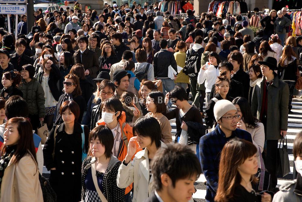over crowded street in Tokyo on Omotesando - Harajuku, Japan
