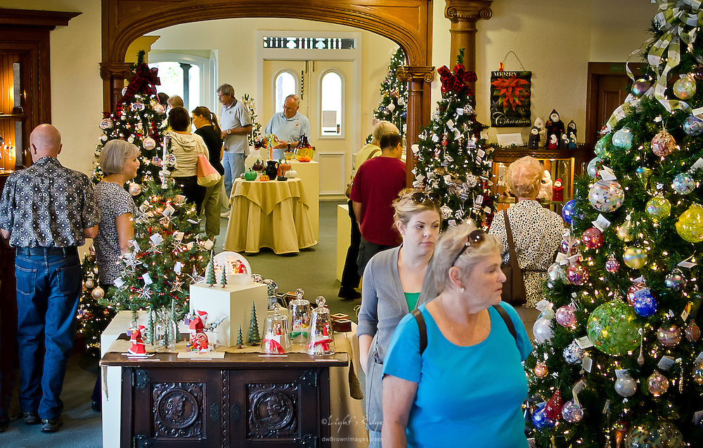 Customers browse holiday items while attending the 2012 Fine Craft Fair at Wheaton Arts.