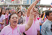 """Apr. 2, 2010 - BANGKOK, THAILAND: Pink Shirt protestors call for an end to Red Shirt protests during a demonstration for peace in Bangkok Friday. Thousands of """"Pink Shirts,"""" who claim to be neither """"Red Shirts"""" nor """"Yellow Shirts"""" nicknames for Thailand's dueling political forces, gathered in Lumpini Park in central Bangkok Friday evening to call for """"peace in the land,"""" a play on the Red Shirts slogan, """"Red in the Land."""" The """"Pink Shirts"""" represented educators, business people and people in the tourist industry, all of which have been hurt by the ongoing political protests that have disrupted life in the Thai capital. The """"Pink Shirts"""" stressed their loyalty to His Majesty Bhumibol Adulyadej, the King of Thailand, and chanted for the Red Shirts to """"Get Out!"""" of Bangkok.    PHOTO BY JACK KURTZ"""