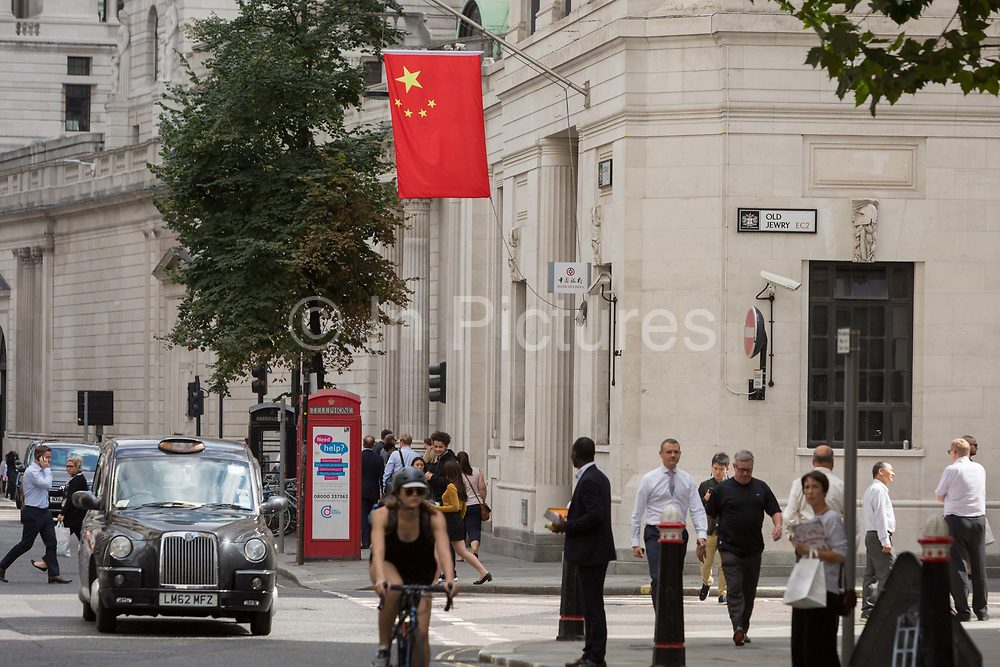 The red Chinese national flag hangs outside the Bank of China on Lothbury Street EC2 in the City of London - the capitals financial district, on 21st August 2018, in London, England. At a time when economic and property investment agreements between Britain and China were confirmed, the Chinese communist states presence in the UK capital is becoming more obvious.