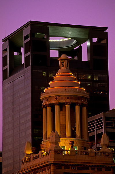 Downtown Houston cityscape featuring Center Point Energy Plaza building and Niels Esperson building at night.