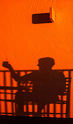 """Redington Beach. Florida, USA. """"Cheers"""",  Silhouette on the wall  Sunset on the Balcony, .<br /> Sunday  09/10/2016 © Peter SPURRIER<br /> LEICA  DIGILUX 2  f4 8mm  3.5MB"""