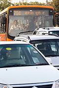 A private bus plies its trade in traffic, New Delhi, India