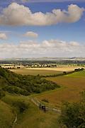 Ramblers walk the footpath overlooking Vale of Pewsey, Wiltshire, England, United Kingdom