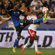 Pegguy Luyindula, (right), New York Red Bulls, is challenged by Shaun Francis, San Jose Earthquakes, in action during the New York Red Bulls Vs San Jose Earthquakes, Major League Soccer regular season match at Red Bull Arena, Harrison, New Jersey. USA. 19th July 2014. Photo Tim Clayton