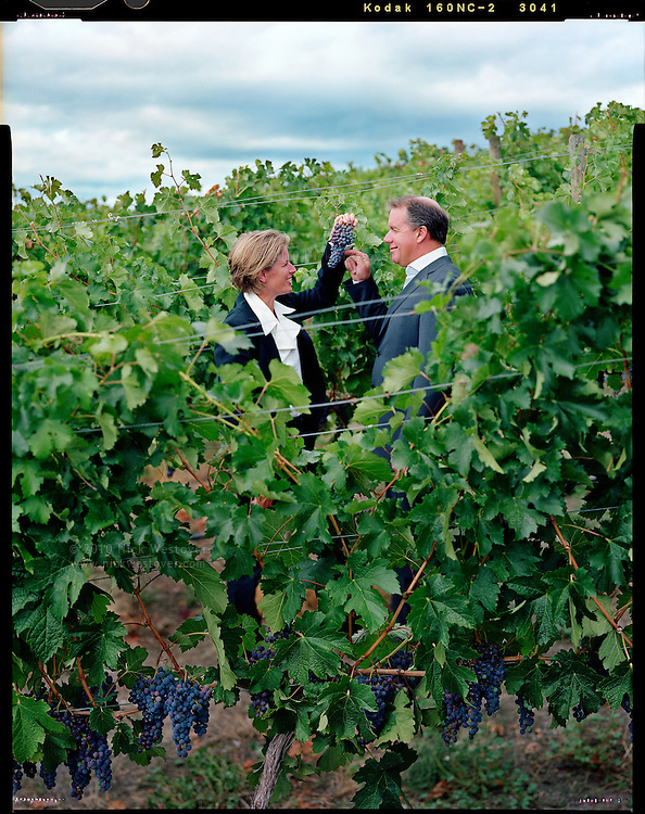 A portrait of Cynthia & David Enns of Laughing Stock Vineyards in their vineyard in Naramata, BC.