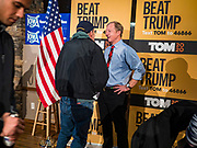 29 JANUARY 2020 - KNOXVILLE, IOWA: TOM STEYER, right, talks to a person at a campaign event in Knoxville, about 40 miles southeast of Des Moines, Wednesday. About 60 people attended the campaign meet and greet. Steyer, a California businessman, is campaigning to be the Democratic nominee for the US Presidency in 2020. Iowa holds the first selection event of the 2020 election cycle. The Iowa Caucuses are Feb. 3, 2020.         PHOTO BY JACK KURTZ