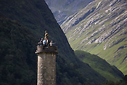 Tourists on Glenfinnan Monument built where Scottish Jacobite Bonnie Prince Charlie first raised his rebel standard in 1745.