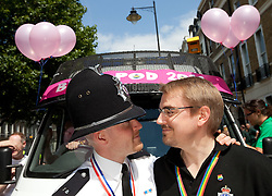 © licensed to London News Pictures. London, UK 02/07/2011. PC David Palmer (left) and his civil partner, Alex Blissett (right) at London's Gay Pride parade. The pair tied the knot 2 years ago and have been a couple for six years. Hundreds of thousands of people turn out to watch the annual London Pride parade. Please see special instructions for usage rates. Photo credit should read Joel Goodman/LNP