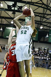 29 January 2011: Stacey Arlis steps in front of Cailee Corcoran for a quick bucket during an NCAA Womens basketball game between the Carthage Reds and the Illinois Wesleyan Titans at Shirk Center in Bloomington Illinois.