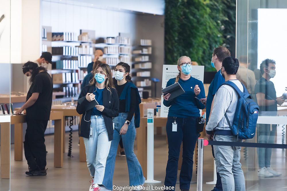 Sydney, Australia. Thursday 7th May 2020. The Apple Store at Bondi Junction in Sydney's eastern suburbs opens as well as all the other Apple stores across Australia as the coronavirus lockdown restrictions ease. Apple has added additional safety procedures including temperature checks and social distancing. Customers leaving Apple Store. Credit Paul Lovelace/Alamy Live News