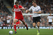 Dael Fry of Middlesbrough (L) in action with Kevin McDonald of Fulham (R). EFL Skybet championship match, Fulham v Middlesbrough at Craven Cottage in London on Saturday 23rd September 2017<br /> pic by Steffan Bowen, Andrew Orchard sports photography.