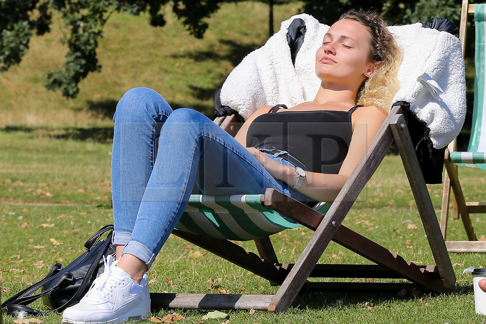 © Licensed to London News Pictures. 22/08/2019. London, UK. Leonie from Germany enjoys the warm and sunny weather in London's Hyde Park. According to the Met Office, the temperatures are forecast to increase to 30 degrees celsius over the bank holiday weekend. <br /> <br /> ***Permission Granted***<br /> <br /> Photo credit: Dinendra Haria/LNP