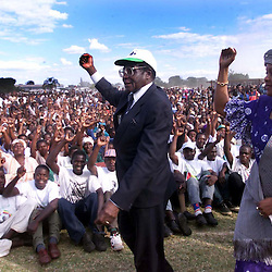 PIC BY PAUL GROVER IN THE MBIZO STADIUM IN THE TOWN OF KWEKWE IN THE MIDLANDS AREA OF ZIMBABWE PIC SHOWS THE PRESIDENT OF ZIMBABWE ROBERT MUGABE and his wife grace GREETING CROWDS AT A ZANU PF ELECTION RALLY PIC PAUL GROVER