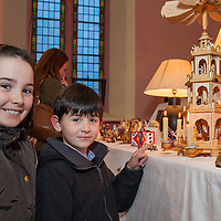 Kate and Jack Lavin from Ennistymon viewing the many Nativity cribs on display at the Liscannor Church