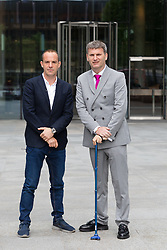 "© Licensed to London News Pictures. 16/05/2018. London, UK. MARTIN LEWIS and his lawyer, Mark Lewis arrive at Facebook offices in London. TV and radio presenter, Martin Lewis has previously launched a High Court legal battle to ""give Facebook a bloody nose"" and change the way it operates over claims the website has been publishing scam adverts. Photo credit: Vickie Flores/LNP"
