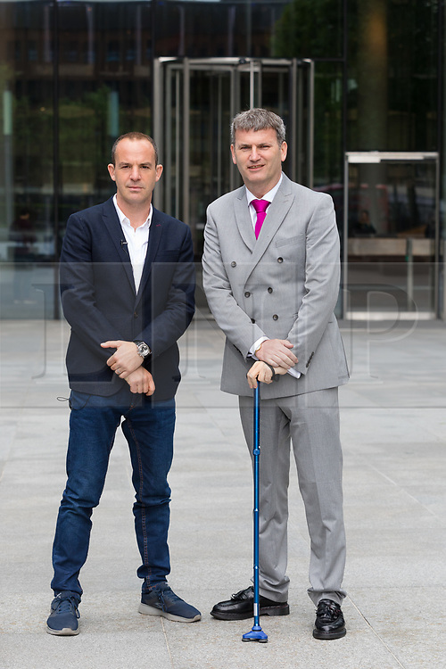 """© Licensed to London News Pictures. 16/05/2018. London, UK. MARTIN LEWIS and his lawyer, Mark Lewis arrive at Facebook offices in London. TV and radio presenter, Martin Lewis has previously launched a High Court legal battle to """"give Facebook a bloody nose"""" and change the way it operates over claims the website has been publishing scam adverts. Photo credit: Vickie Flores/LNP"""