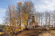 A church hidden in an aspen tree forest