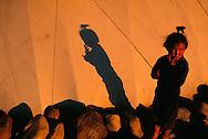 Chukchi Girl in front of the family Yaranga tent on the tundra, Chukotka, Russia