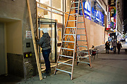 New York, NY - 3 November 2020. New York City anticipates presidential election results as polls in some states close. Workers board up a branch of Bank United on the corner of Sixth Avenue and West 36th St in anticipation of unrest as election results are announced.