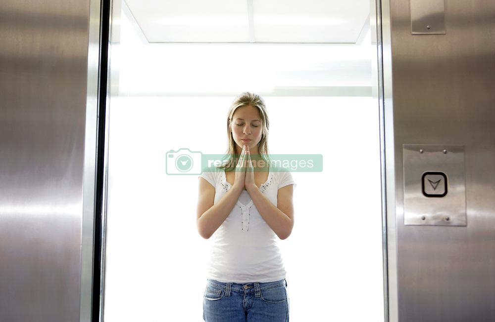 Jun. 05, 2008 - Girl in lift. Model and Property Released (MR&PR) (Credit Image: © Cultura/ZUMAPRESS.com)