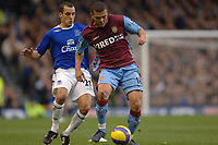 Photo: Paul Greenwood.<br /> Everton v Aston Villa. The Barclays Premiership. 11/11/2006. Villa's Wilfred Bouma, right, shields the ball from Leon Osman.