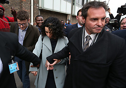 © Licensed to London News Pictures. 06/01/2016. Croydon, UK. Former Chelsea team doctor EVA CARNEIRO (C) leaves Croydon Employment Tribunal with her husband JASON DE CARTERET (R) . Carneiro is claiming constructive dismissal against Chelsea football club. Photo credit: Peter Macdiarmid/LNP