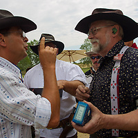 Judges discuss competition rules during the Cowboy Action Shooting European Championship in Dabas, Hungary on August 11, 2012. ATTILA VOLGYI
