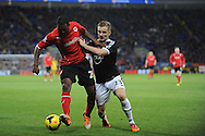 Cardiff City's Kevin Theophile Catherine challenges Southampton's Luke Shaw during the Barclays Premier league, Cardiff city v Southampton at the Cardiff city Stadium in Cardiff,  South Wales on Boxing day, Thursday 26th Dec 2013. <br /> pic by Jeff Thomas, Andrew Orchard sports photography.