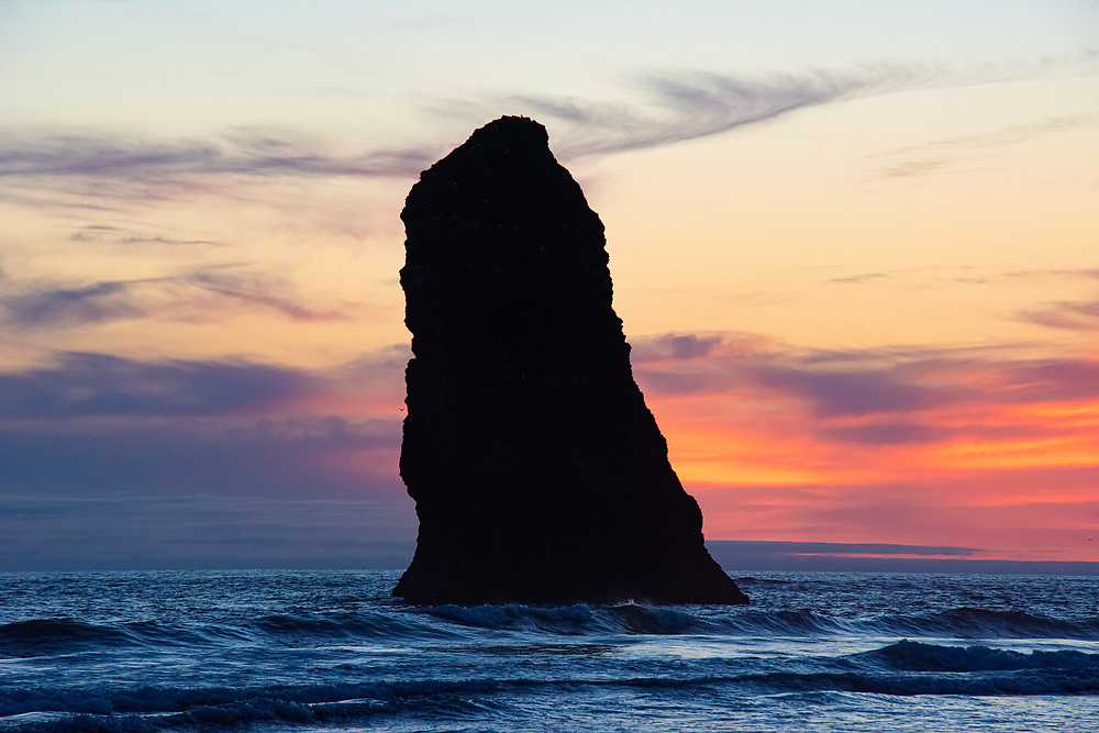 """One of """"The Needles"""" - one of three tall basalt spires of volcanic rock near the massive Haystack Rock on Oregon's coast on Cannon Beach. Around about 15 to 16 million years old, these columns are very slowly eroding with every wave and every changing tide."""