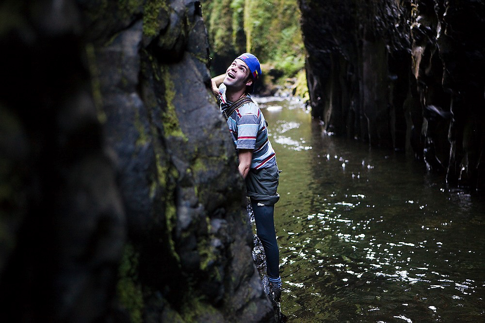 Hamilton Boyce scrambles the canyon wall to avoid a deep pool in Oneonta Gorge, a tight mossy slit cut into the bedrock in Oregon's Columbia River Gorge National Scenic Area.