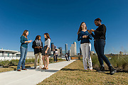 "Science teacher Jamie Scott, left, talks with students on the ""Green Roof"" at Carnegie Vanguard High School, December 17, 2012, in Houston."